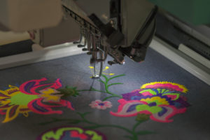 Custom clothing embroidery - hand vs machine - which is best